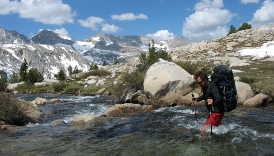 Braving the snowmelt as we begin our hike back to the trailhead.